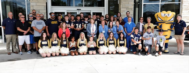 The Lancaster High School football team, staff and cheerleaders stand with members of the Fairfield Medical Center maternity ward Monday, June 28, as the Lancaster Golden Gales Touchdown Club donated 500 foam footballs to be given to newborns and their families at the hospital. It's one effort the Touchdown Club is using to give back to the community.