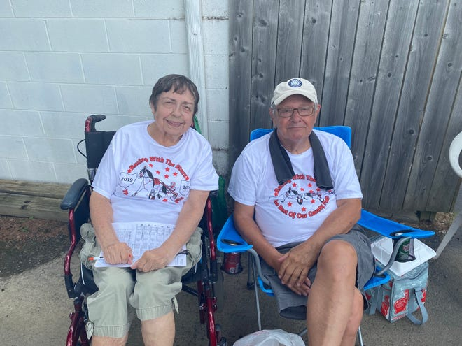 Judy Graves, 82, watches the harness races with her husband Art Graves, 81, at the Marion County Fair Monday, June 28, 2021. The Hilliard couple like to attend county fairs across Ohio for horse races.
