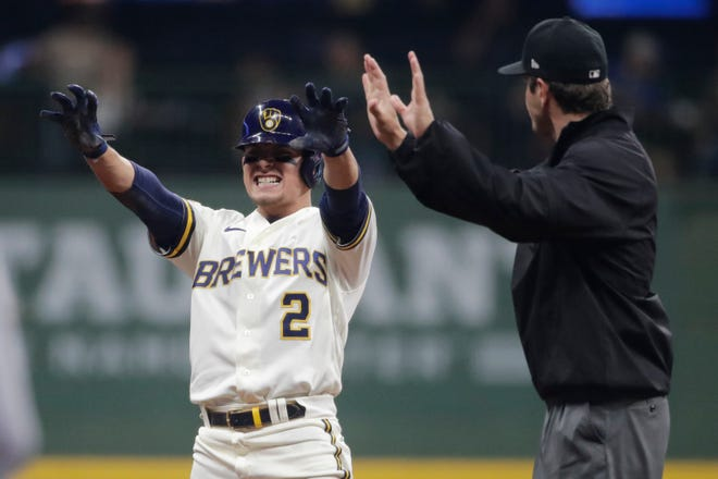 Milwaukee Brewers' Luis Urias gestures after hitting an RBI-double during the eighth inning against the Chicago Cubs on June 28.