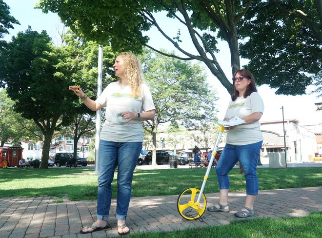 Plymouth Art in the Park director Raychel Rork, left, and co-director Kathy Dryja have had to begin to scout and mark off dimensions for booths for the upcoming festival which will begin July 9, 2021. The art festival will take place in and around Plymouth's Kellogg Park.