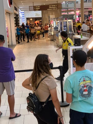 Glass fragments are scattered on the ground of the Arrowhead Towne Center in Glendale after a piece of laminated decorative glass fell from the ceiling Saturday, June 26, 2021.