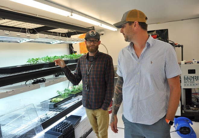 CEO Eric Hagen, right, and COO Jonathan Hunt give a tour of the Native Nations Cannabis facilities on the Flandreau Santee Sioux Tribe reservation Tuesday.