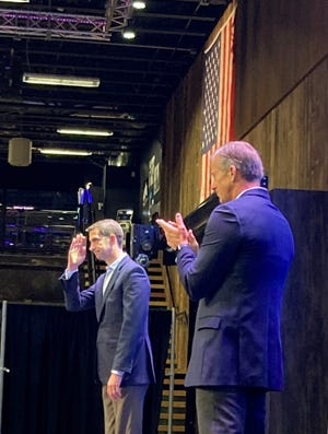 Arkansas Sen. Tom Cotton acknowledges a standing ovation during a South Dakota Republican Party fundraiser on June 29, 2021 in Sioux Falls. Cotton was the keynote speaker and hosted by Sen. John Thune, who is also applauding.