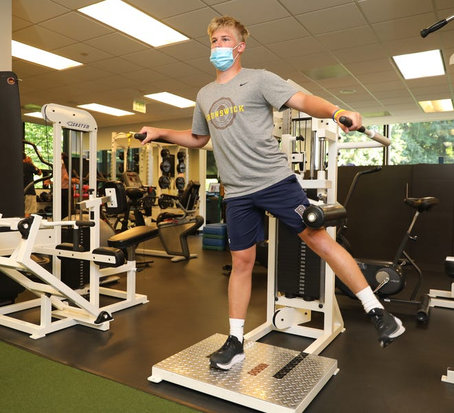 Charlie Gaynor, 16, from Bedford, strengthens his legs after an ACL injury, during a physical therapy session at Armonk Physical Therapy & Sport Training June 29, 2021. Gaynor, a lacrosse player attends the Brunswick School in Greenwich, Connecticut.