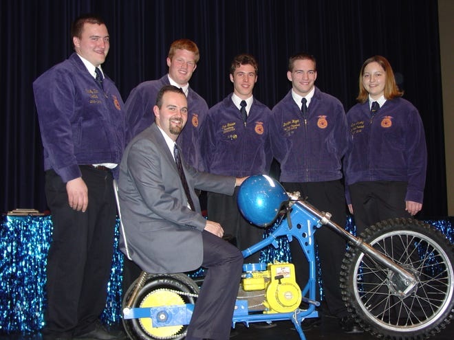 In 2003, Sauk Prairie ag teacher Jeff Hicken's students built him an FFA motorcycle. The late Matt Anderson, second from left, went on to use the motorcycle in 2007 for his retiring address as the State FFA President.