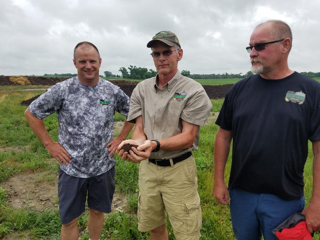 The Roche brothers, from left, David, Kevin and Dennis are aiming to farm in a way that they constantly improve the soil.