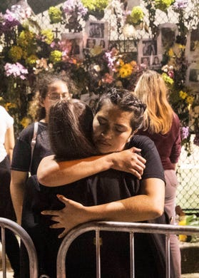 Florence Garcia hugs a woman at the memorial wall of those missing in the Champlain Towers collapse in Surfside, Fla. on Monday, June 28, 2021.