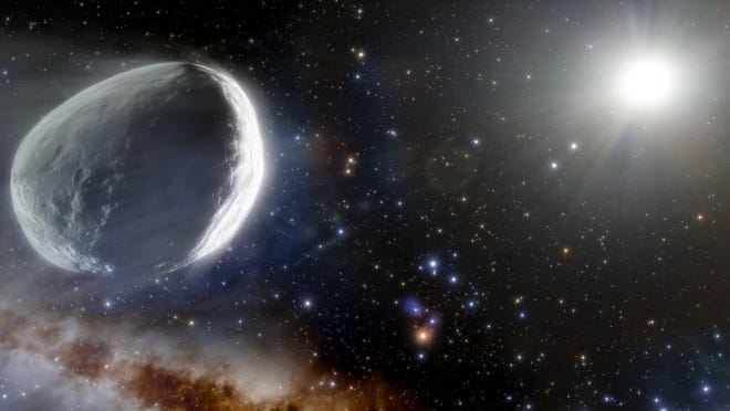 This illustration shows the distant Comet Bernardinelli-Bernstein as it might look in the outer solar system. Comet Bernardinelli-Bernstein is estimated to be about 1,000 times more massive than a typical comet, making it arguably the largest comet discovered in modern times.