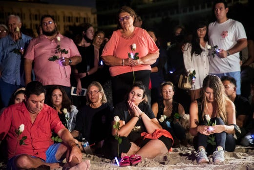 People attend a vigil for those missing in the Champlain Condo collapse in Surfside, Fla on Monday, June 28, 2021.