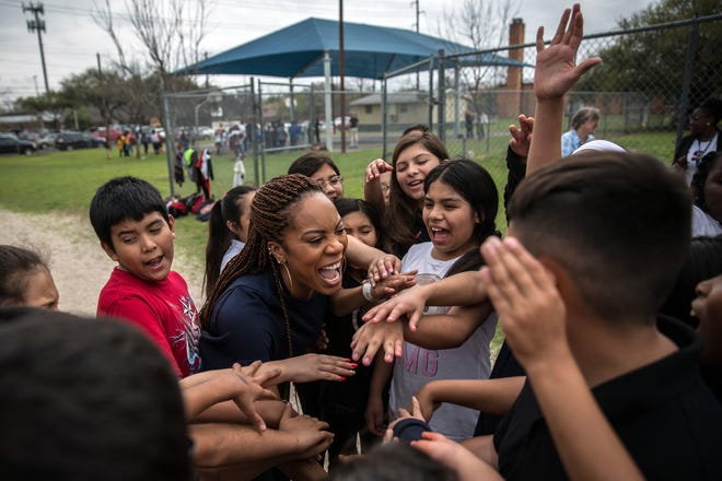 Sanya Richards-Ross meets with kids at Brooke Elementary School in 2017 to encourage physical fitness. Now the Olympian is trying to encourage moms to be active with their children through a partnership between her MommiNation and Marathon Kids.