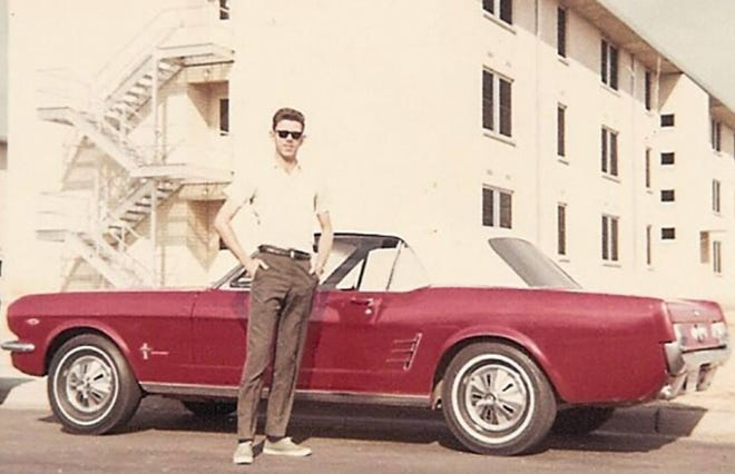 Denny Bowsher shows off the 1966 Ford Mustang that he bought in 1968 between tours of duty in Thailand during the Vietnam War.