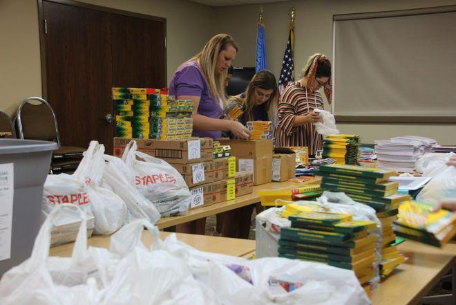Members of the Ardmore Young Professionals (now known as FUEL ARDMORE) wrap up the stuff the backpack program in 2019.