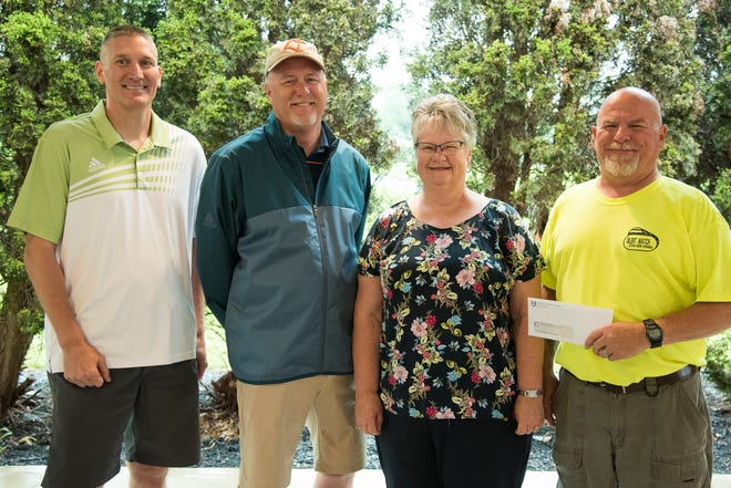 From left, Jason Szmaina, manager of the Radiology Department at University Hospitals Samaritan Medical Center; Todd Harford, president of UHSMC; Jane Roland, board member of Silent Watch Veterans Suicide Awareness; and Tim Chandler, president of Silent Watch Veterans Suicide Awareness.