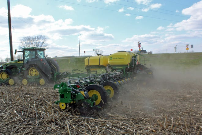 Van Wall Equipment donated the use of a John Deere 1775 planter to plant beans in the Nevada FFA's no-till test plot April 24. A field day is being held Friday to show the results and promote conservation farming techniques.