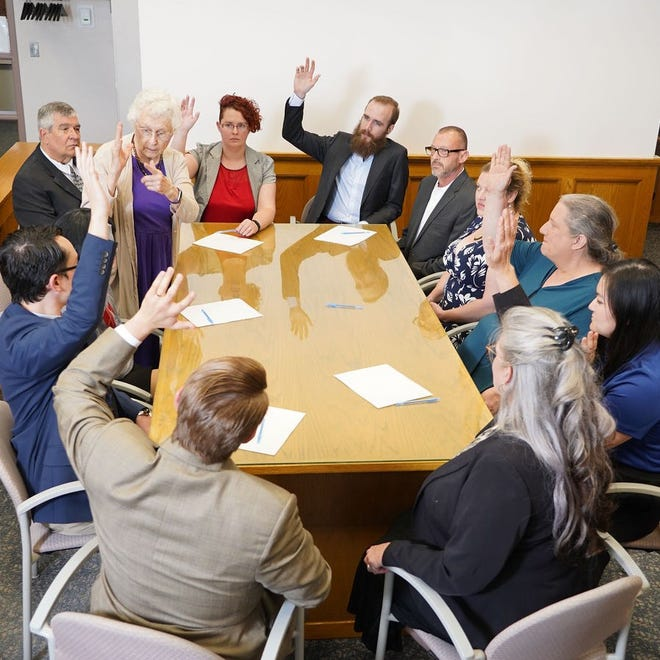"""Former Story County Attorney Mary Richards, standing, plays Juror 1, the jury foreperson in ACTORS' production of """"12 Angry Jurors."""""""