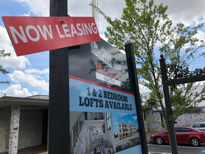 A sign outside the former Richmond County Board of Education building on Heckle Street advertises apartments for lease.