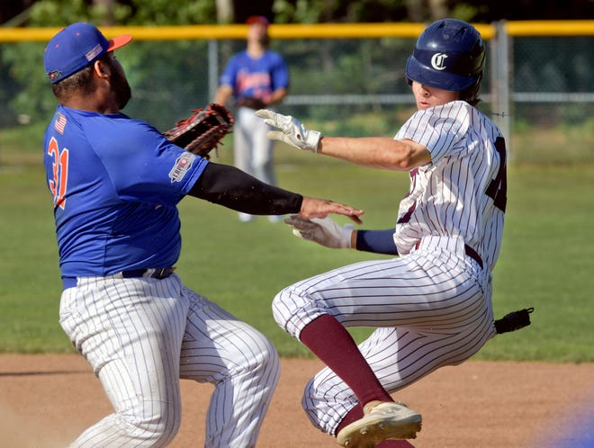 Brooks Baldwin of Cotuit arrives safely at first as he collides with Hyannis first baseman Marco Pujols at Cotuit Monday.