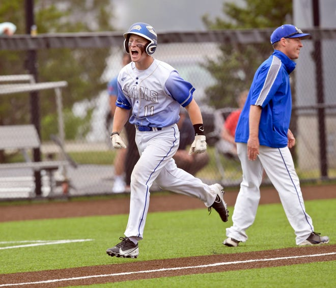 Will Levesque of St. John Paul II celebrates heading for  home after hitting a grand slam against Cohasset.