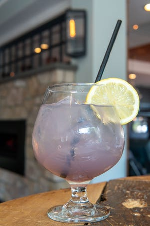The Blue Sapphire is made with Bombay Blue Sapphire gin, St-Germain Elderflower Liqueur and lavender simple syrup. It's available at Earl's New American at Peddler's Village.