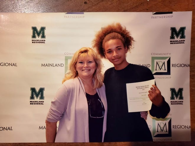 Tyrek Cooper, right, with his favorite high school teacher Josephine Carney, left. Cooper graduated from Mainland Regional High School in 2017 and went on to attend Georgian Court.