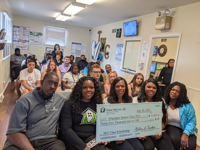 Scholarships were presented this week to different students from Aliquippa High School by Tucked With Care, LLC, which is also located in the city.