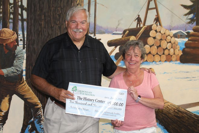 David Butts of the Cheboygan County Community Foundation presented Kay Forster of the History Center of Cheboygan with a grant for $5,000 to help develop exhibits that portray the history of the county. This grant, along with two more donations to the history center, will help keep the museum open to the public. The museum will be opening back up for tours July 1.