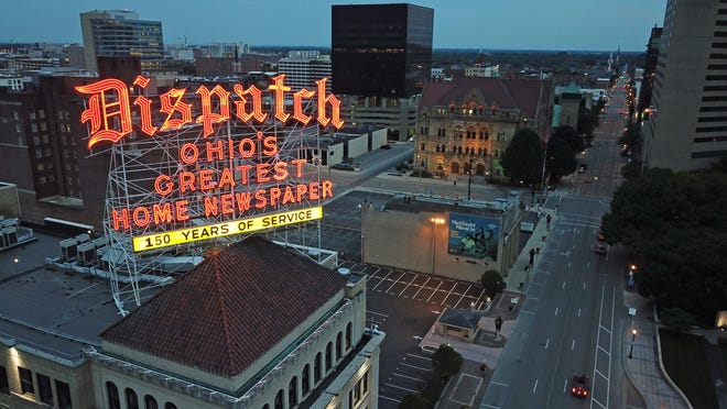 """The Dispatch sign has illuminated Downtown Columbus for decades and was recently updated to reflect the newspaper's """"150 years of service"""" to the community."""