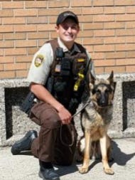 Rex is pictured with Polk County Deputy Ben Stout