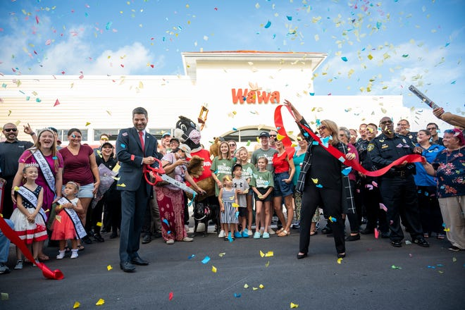 Wawa representatives, employees and guests celebrate at the ribbon cutting of the Wawa in Mount Dora on Wednesday. [Cindy Peterson/Correspondent]