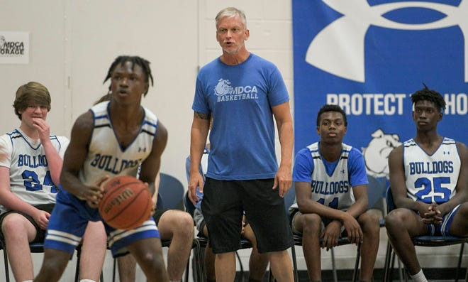 Mount Dora Christian Academy coach Steven Hayes instructs Isaiah Bryant (4) from the sidelines during a game against Winter Garden Foundation Academy at the MDCA Summer Shootout in Mount Dora on Friday at Brackett Gymnasium in Mount Dora. [PAUL RYAN / CORRESPONDENT]