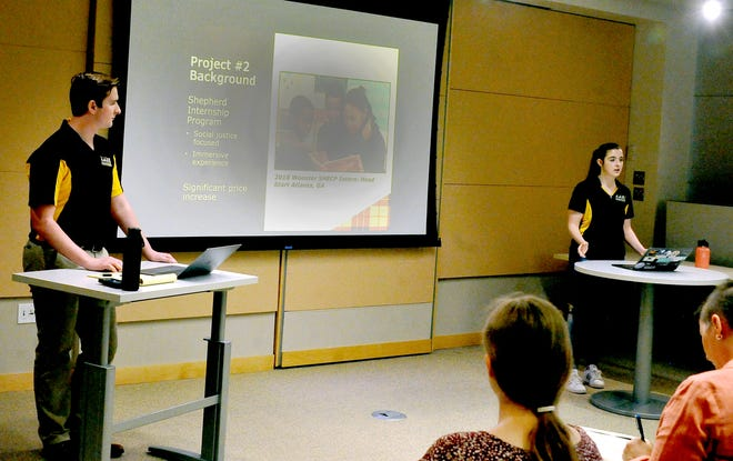 Spencer Gaitsch (left) and Audrey Holder (right) present their summer research projects on students interning with community partners to a group gathered on the College of Wooster Campus. They gathered research and met with local community groups for a total of eight weeks before presenting their findings June 30.