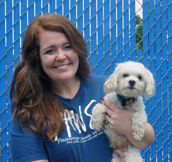 Wayne County dog warden Katelyn Lehman and Luca, an adoptable dog at the center.