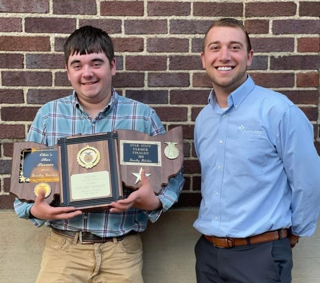 Chase Stitzlein, a member of the West Holmes FFA chapter, was named Star Farmer of Ohio and will compete in the Regional Star Farmer competition as a part of the Eastern States Exposition in September. He is shown with Micah Mensing of Farm Credit, which recogned Stitzlein at a dinner.