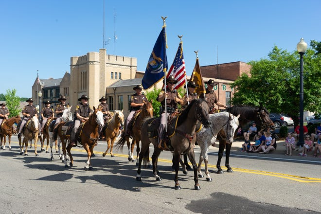 Members of the Lenawee County Sheriff's Office Mounted Division ride in the 2018 Civitan of Lenawee Fourth of July parade in Adrian. This year's parade is at 1 p.m. July 4.