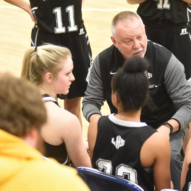 Ledford's Chris Doby talks to his team during a girls basketball state playoff game in 2019. Doby was just named head football coach at Ledford. [Sue Whitman photograph]