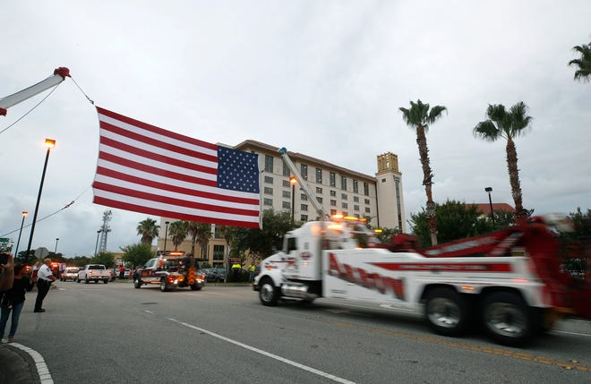 Wreckers drivers stage a rally in support of Jason Raynor outside Halifax Health in Daytona Beach, Tuesday, June 29, 2021.