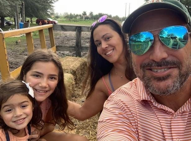 Marcus Joseph Guara, pictured here with daughters Emma Guara, left, and Lucia Guara and his wife Anaely Rodriguez, died in the Surfside condo collapse. Marcus was 52.