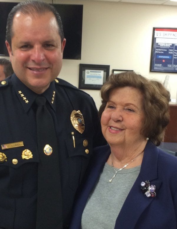 Hilda Noriega and her son, North Bay Village Police Chief Carlos Noriega, at his swearing-in ceremony. Hilda Noriega was found dead after the Surfside condo collapsed. She was 92.