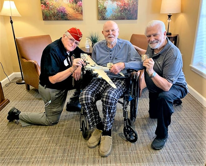 World War II fighter pilot Gordon Blythe, center was presented coins from retired Marine Corps officer and Delaware Veterans Commissioner Bill Farley, left, and Delaware Veterans Coalition President Dave Skocik, right.