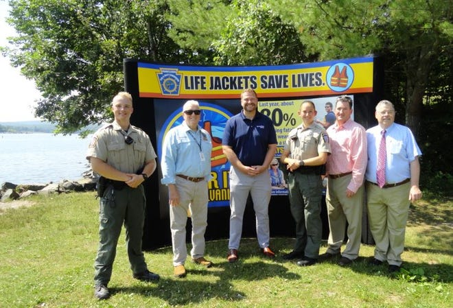 BE SAFE ON THE LAKE - Brookfield Renewable and PA Fish & Boat Commission (PFBC) urges everyone planning to be on Lake Wallenpaupack for the 4th of July weekend to be safe and follows the regulations, while enjoying the lake. At Mangan Cove, June 29 from left were PFBC Officer Matthew Deitrich; PFBC Commissioner Charles Charlesworth; Brian Noonan, Brookfield Renewable; PFBC Officer Emily Borger; State Rep. Mike Piefer (R-139th) and Tony Herzog, Field Representative for PA Senator Lisa Baker (R-20th).