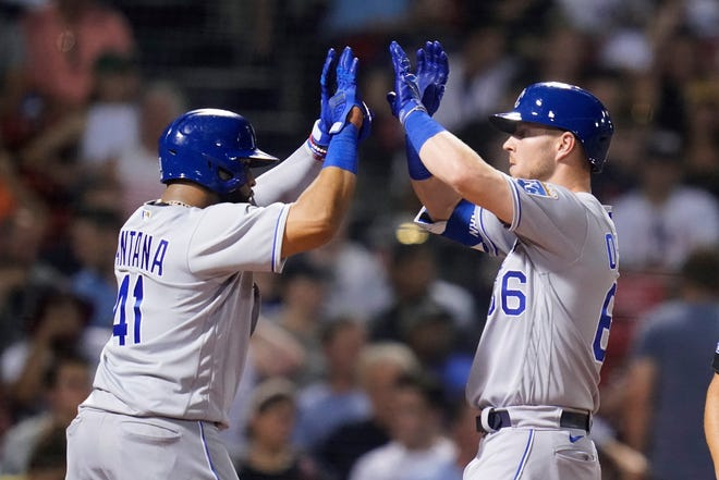Kansas City Royals DH Ryan O'Hearn, right, is congratulated by Carlos Santana (41) after hitting a two-run home run during the fifth inning of Tuesday's game against the Boston Red Sox at Fenway Park. The home run put the Royals ahead 6-5 but they lost 7-6, their seventh straight defeat,