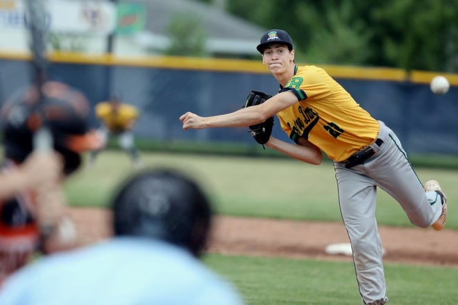 Notre Dame High School's Josh Smith (22) delivers a pitch during their game against Mediapolis High School Tuesday June 29, 2021, at Notre Dame's Winegard Field.