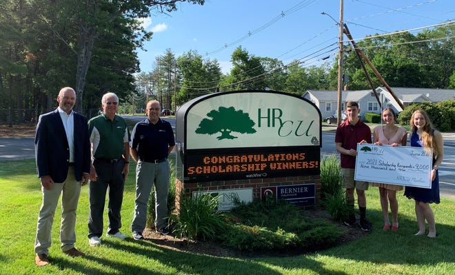 From left to right, Holy Rosary Credit Union President and CEO Brian Hughes, Scholarship Committee Member Jim Brock, Board Chairman Dana Flanders, and 2021 scholarship recipients Kevin Golightly, Lily Stinchfield and Lindsey Hatfield.