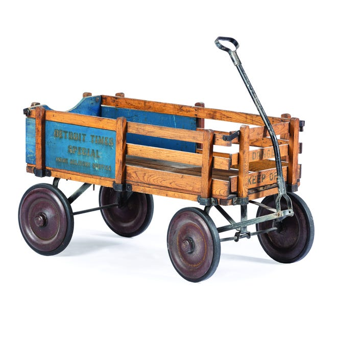 This stenciled wooden wagon with removable side panels from the early 1900s sold at a Cowan auction for $160.