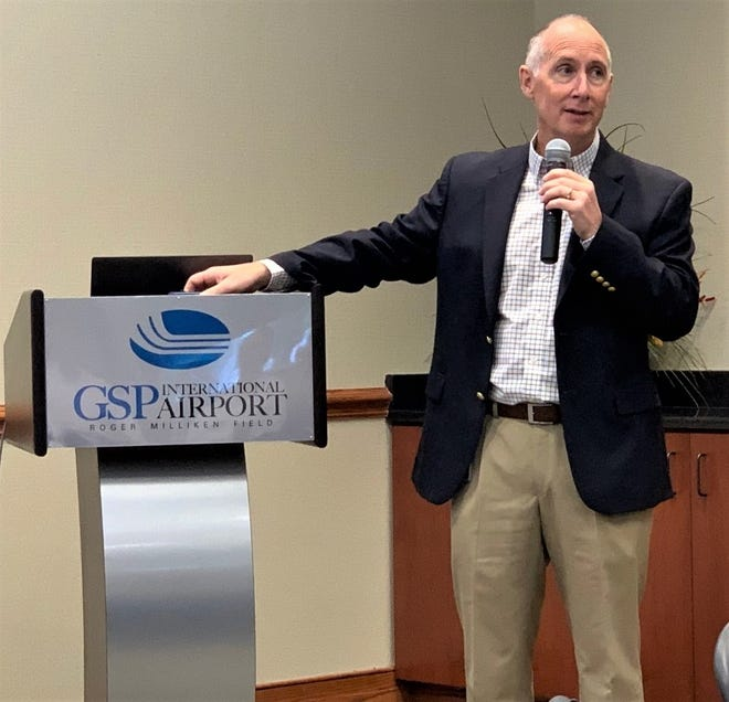 GSP Airport President and CEO Dave Edwards talks about future expansion plans with business leaders, Tuesday.