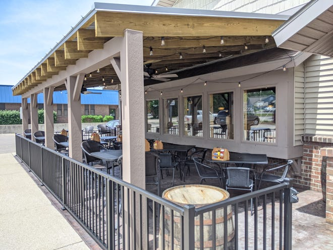 James Street Inn, 255 James St. in Holland Township,recentlyfinished construction on its wood-covered, permanent patio.