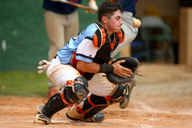 Post 77 catcher Brennan Chapman tries to stop a throw to home against the Gaston Braves on July 6, 2019, at East Henderson High School.