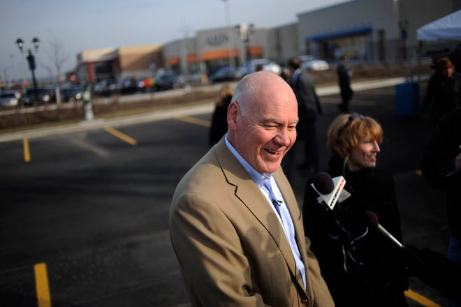 In this 2013 file photo, East Peoria mayor Dave Mingus is all smiles for the ribbon-cutting marking the official opening of the Levee District shopping center.