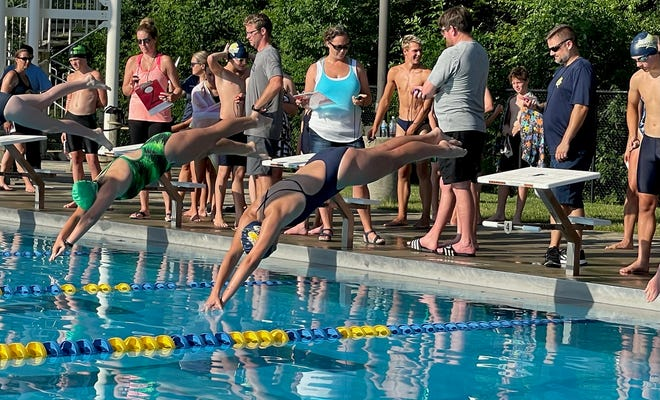 Georgia Brown swims in a meet for the Tallmadge Marlins against the Maplewood Gators on Monday, June 28, 2021