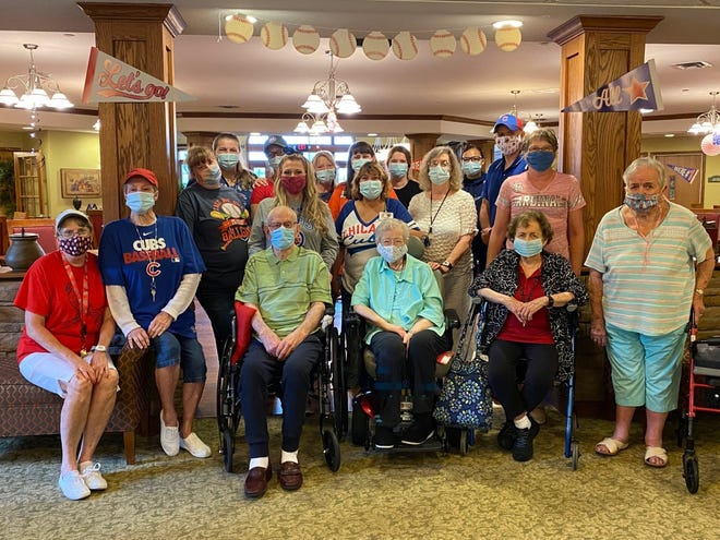 """Residents of Castle Manor celebrated Wednesday with a theme of """"Take Me out the the Ballgame"""" which pitted the I-55 rivals of the Cardinals and the Cubs. Despite the rain residents enjoyed peanuts and popcorn along with a ballpark lunch of hot dogs and hamburgers."""